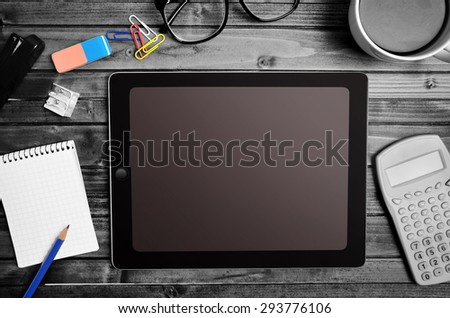 Tablet empty screen with calculator and notepad - stock photo