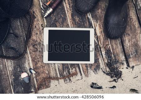Tablet fisherman hero header - stock photo