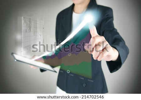 Tablet in hands, Touch graph - stock photo