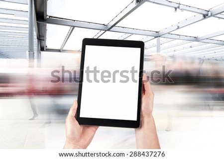 tablet in the hands and the crowd of people in the background - stock photo