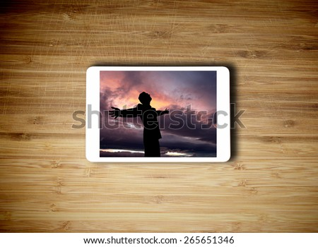 Tablet lying on the table with success concept - stock photo