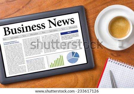 Tablet on a desk - Business News - stock photo
