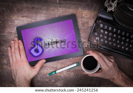 Tablet on a desk, concept of data protection, purple - stock photo