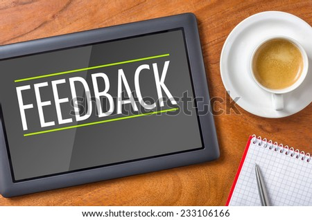 Tablet on a desk - Feedback - stock photo
