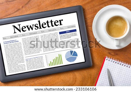 Tablet on a desk - Newsletter - stock photo