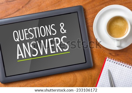 Tablet on a desk - Questions and Answers - stock photo