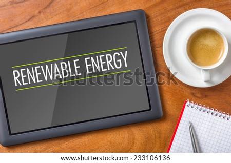 Tablet on a desk - Renewable Energy - stock photo