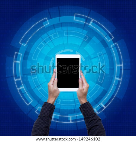 Tablet on hands with blue digital background - stock photo