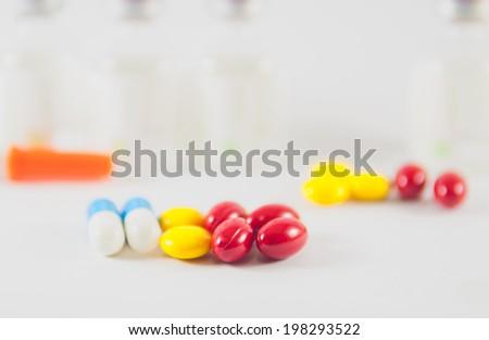 Tablet on medicine vials background - stock photo