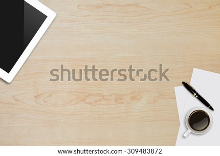 Tablet ,Page paper,Pen,Coffee Cup on wood table background texture with copy space and text space - stock photo