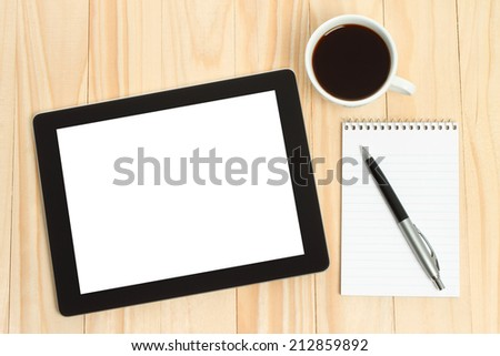 Tablet PC, cup of coffee with office supplies on wooden background   - stock photo