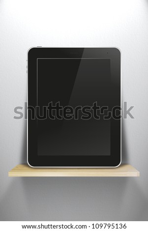 tablet pc, on wood shelves and white wall background - stock photo