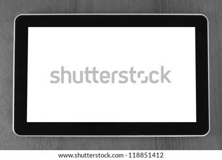 Tablet PC on wooden background close-up - stock photo