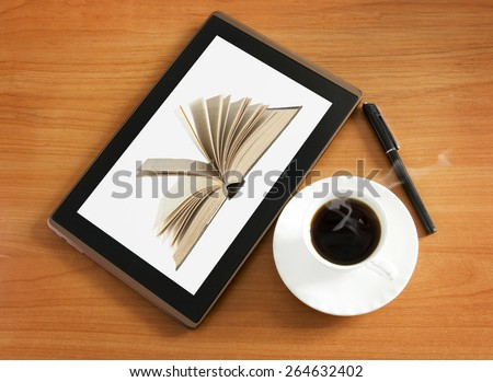 Tablet pc with book, hot coffee cup and pen. Education concept - stock photo