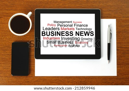 Tablet PC with business news, smart phone, paper, pen and cup of coffee on wooden background   - stock photo