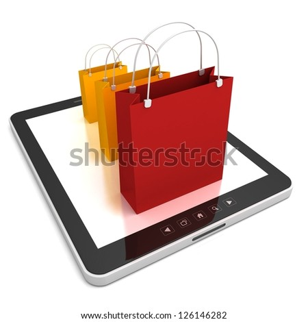 tablet PC with colorful sale bags - stock photo