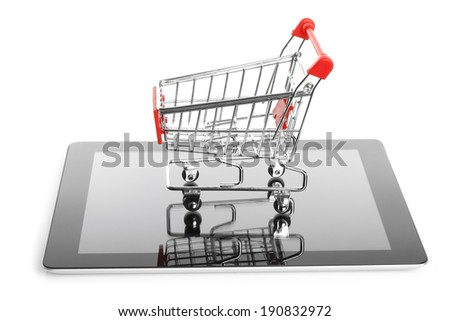 Tablet PC with shopping cart on white background - stock photo