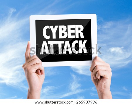 Tablet pc with text Cyber Attack with sky background - stock photo