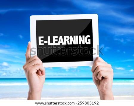 Tablet pc with text E-Learning with beach background - stock photo