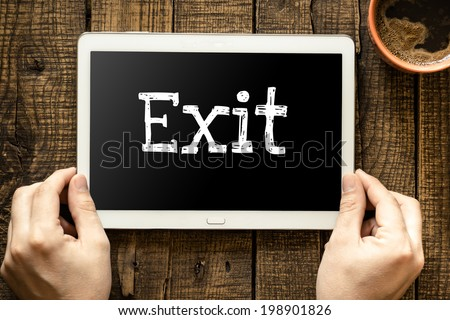 "Tablet pc with text ""exit"" which holding man - stock photo"