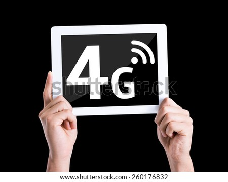 Tablet pc with text 4G isolated on black background - stock photo