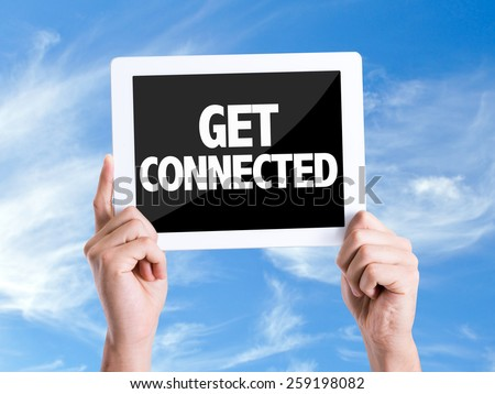 Tablet pc with text Get Connected with sky background - stock photo