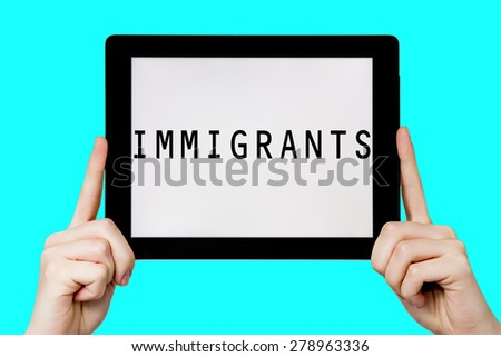 Tablet pc with text immigrants with blue background - stock photo