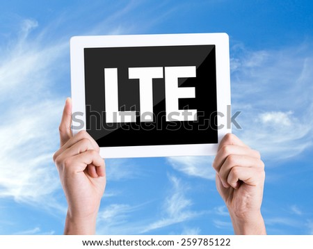 Tablet pc with text LTE with sky background  - stock photo