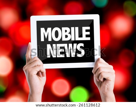 Tablet pc with text Mobile News with bokeh background - stock photo