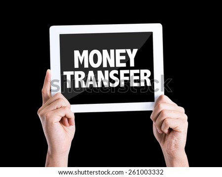 Tablet pc with text Money Transfer isolated on black background - stock photo