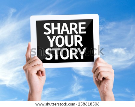 Tablet pc with text Share Your Story with sky background - stock photo