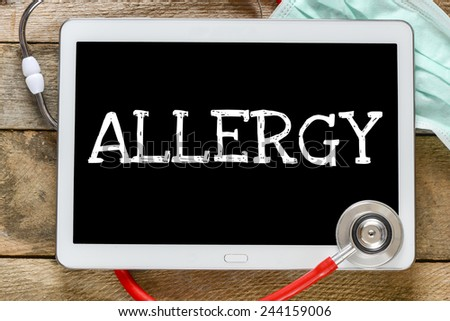 Tablet pc with word Allergy. Tablet pc with word Allergy and stethoscope, medicine concept - stock photo
