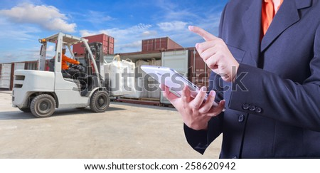 tablet to handle export and import goods prepare the delivery of powder compactos at dock yard - stock photo