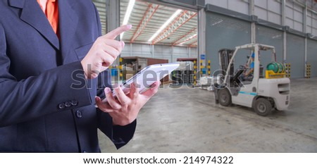tablet to handle export and import goods prepare the delivery of product at dock in warehouse - stock photo
