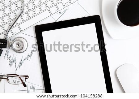 tablet touch pad computer gadget is in the doctor's office - stock photo