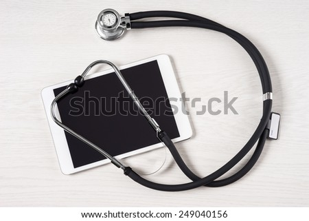 Tablet touch pad computer is in the doctor office - stock photo
