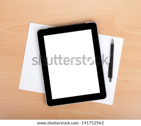 Tablet with blank screen and pen over white papers. View from above - stock photo