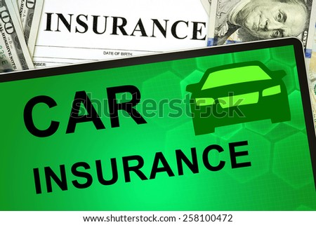 Tablet with car insurance online and money.  - stock photo