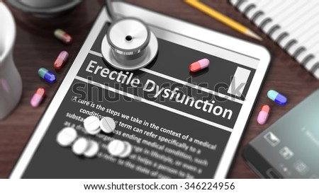 "Tablet with ""Erectile Dysfunction"" on screen, stethoscope, pills and objects on wooden desktop. - stock photo"