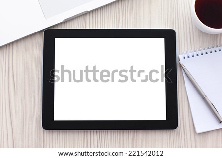 tablet with isolated screen is on the table in the office