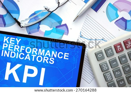 Tablet with Key Performance Indicators  , KPI , graphs and calculator.