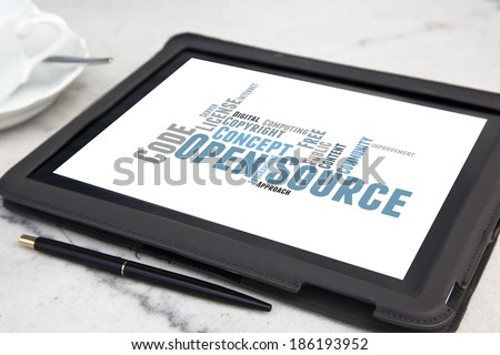 tablet with open source software word cloud - stock photo