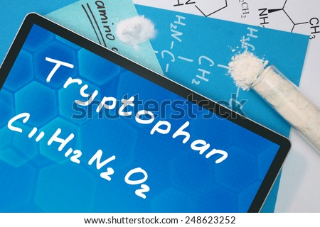 Tablet with the chemical formula of  Tryptophan  - stock photo