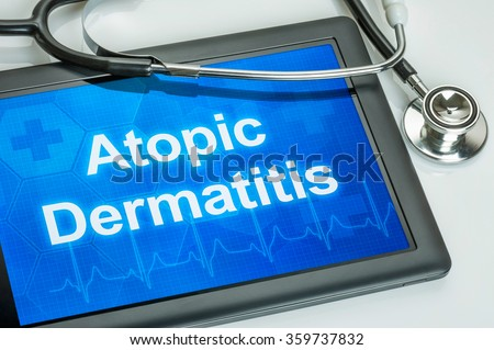 Tablet with the diagnosis Atopic Dermatitis on the display - stock photo