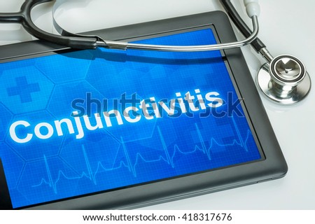 Tablet with the diagnosis conjunctivitis on the display - stock photo