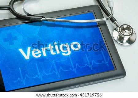 Tablet with the diagnosis Vertigo on the display - stock photo