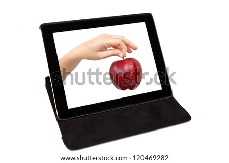 tablet with the hand and a red apple on the screen in black carrying case - stock photo