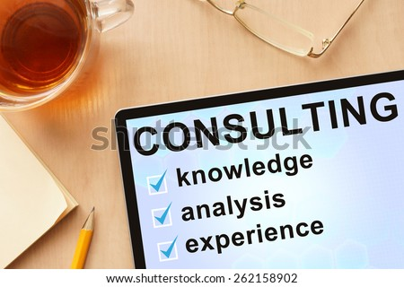 Tablet with word consulting. Business concept. - stock photo
