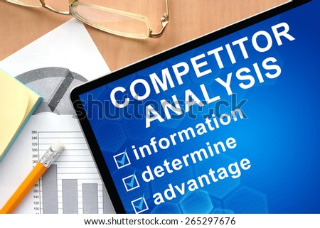 Tablet with words competitor analysis. Business and management concept. - stock photo