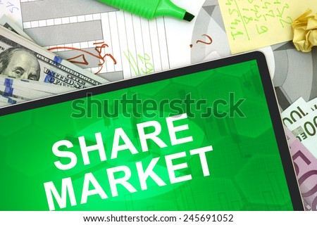 Tablet with words Share Market with dollars and euro. Business concept - stock photo